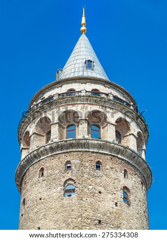 Galata Tower at blue sky, one of the most striking Istanbul landmarks, Turkey - stock photo