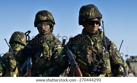 GALATI, ROMANIA - APRIL 10: Romanians military with semiautomatic rifle in military polygon in the exercise SABER JUNCTION 15 on Galati, Romania, 10 april 2014.  - stock photo