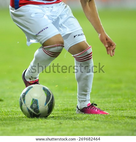 GALATI, ROMANIA - APRIL 6: Unknown football players performs during the soccer game in Liga 1, score 0-1, Otelul Galati (red and white) on April 6, 2014 in Galati, Romania - stock photo