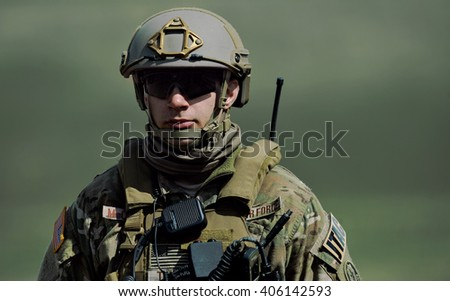 GALATI, ROMANIA - APRIL 22: US military with semiautomatic rifle in military polygon in the exercise Wind Spring 15 on Galati, Romania, 22 april 2015.