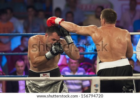 GALATI, ROMANIA - AUGUST 23: Cristian Ciocan (Hammer)(L) and Leif Larsson(R) fight at the WBO Heavyweight Europe title,  on August 23, 2013, in Galati, Romania.