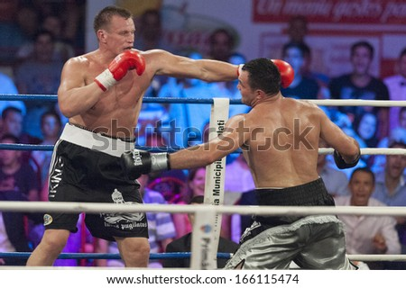 GALATI, ROMANIA - AUGUST 23: Cristian Ciocan (Hammer)(R) and Leif Larsson(L) fight at the WBO Heavyweight Europe title,  on August 23, 2013, in Galati, Romania.