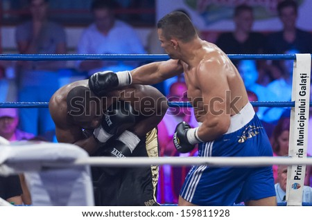 GALATI, ROMANIA - AUGUST 23: Danny Wliliams (L) and Marcin Rekowski (R) fight at the WBO Heavyweight , on August 23, 2013, in Galati, Romania.
