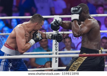 GALATI, ROMANIA - AUGUST 23: Danny Wliliams (R) and Marcin Rekowski (L) fight at the WBO Heavyweight , on August 23, 2013, in Galati, Romania.