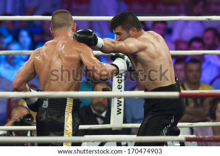 GALATI, ROMANIA - AUGUST 23:Gokalp Ozekler (L) and Istvan Szili(R) fight at the WBO middelweight Intercontinental title,  on August 23, 2013, in Galati, Romania.