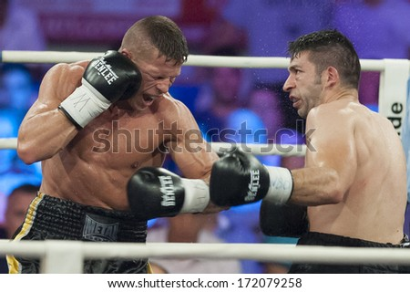 GALATI, ROMANIA - AUGUST 23: Gokalp Ozekler (L) and Istvan Szili(R) fight at the WBO middelweight Intercontinental title,  on August 23, 2013, in Galati, Romania.