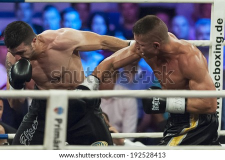 GALATI, ROMANIA - AUGUST 23:Gokalp Ozekler (R) and Istvan Szili(L) fight at the WBO middelweight Intercontinental title,  on August 23, 2013, in Galati, Romania.
