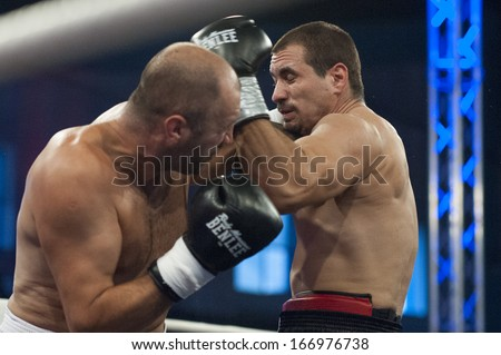 GALATI, ROMANIA - AUGUST 23:Octavian Lehadus (L) and Gabor Nagy(L) fight at the WBO Cruiserweight,  on August 23, 2013, in Galati, Romania.