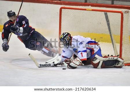 GALATI, ROMANIA - JANUARY 21: Unidentified hockey players compete during Hockey match HC Dunarea Galati vs HC Steaua Rangers, score 2-4, on January 21 , 2014 in Galati, Romania  - stock photo