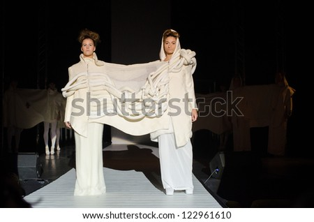 GALATI, ROMANIA - NOVEMBER 24: Fashion models wear clothes from young designers, in National Student Fashion Festival Extravagance on November 24, 2012 in Galati, Romania - stock photo