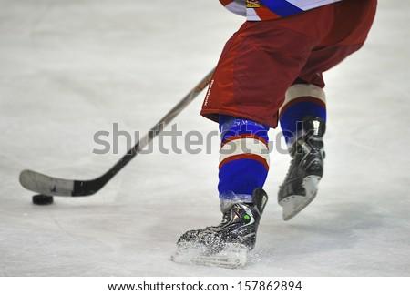 GALATI, ROMANIA - NOVEMBER 17: Unidentified players in action at hockey match with CSM Dunarea Galati (white) and CSS HSC Csikszereda (blue), November 17, 2012 in Galati, Romania - stock photo