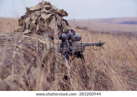 GALATI, ROMANIA - OCTOBER 8: English soldier with Barrett 98 Bravo in Romanian military polygon in the exercise Smardan Danube Express 14 on Galati, Romania, 8 october 2014. - stock photo