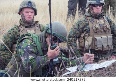 GALATI, ROMANIA - OCTOBER 8: Romanian soldier requesting air support in Romanian military polygon in the exercise Smardan Danube Express 14 on Galati, Romania, 8 october 2014. - stock photo