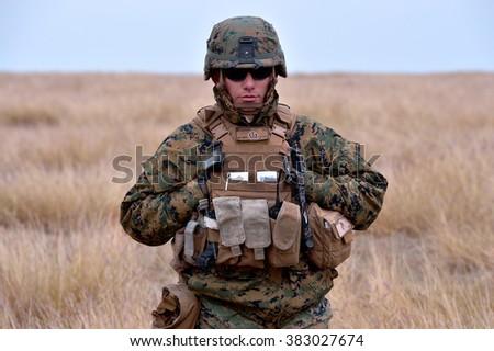 GALATI, ROMANIA - OCTOBER 8: US Marines in Romanian military polygon in the exercise Smardan Danube Express 14 on Galati, Romania, 8 october 2014. - stock photo
