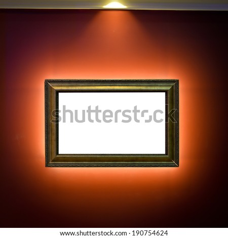 Gallery Interior with empty frame on red wall  - stock photo