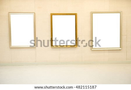 Gallery interior with empty frame on wall