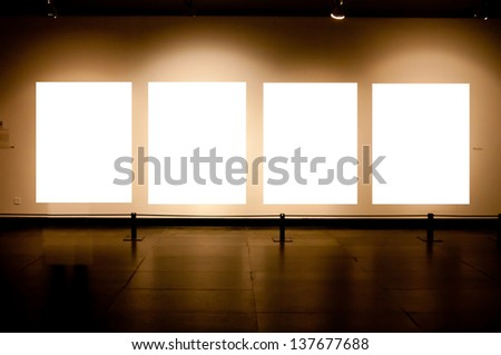 Gallery Interior with empty frames on wall - stock photo