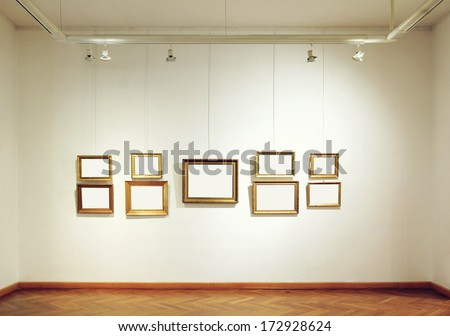 Gallery wall with empty picture frames - stock photo
