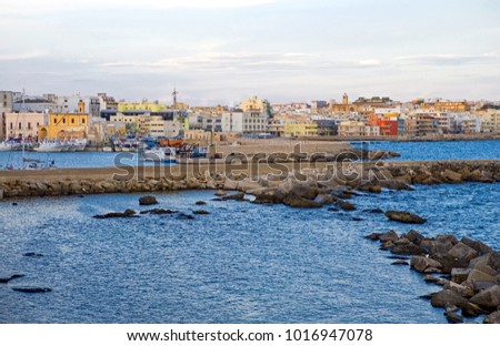 Gallipoli, Italy - August 27, 2006: Panoramic view of the harbor in front of the city center