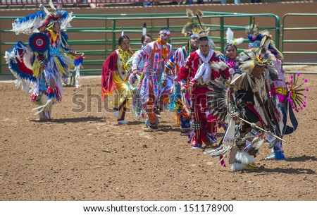GALLUP , NEW MEXICO - AUGUST 10 : An unidentified Native Americans takes part at the opening ceremony of the 92nd annual Indian Rodeo in Gallup, NM on August 10 2013