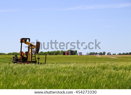 GALVA, KANSAS, USA - MAY 17, 2015: Borehole pumps in the middle of grassland and fields near Galva.