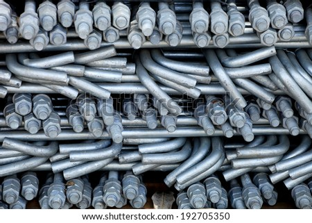 Galvanized Anchor Steel rod bunch in warehouse.