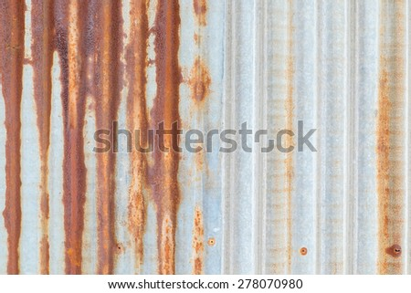 Galvanized iron as corrugated sheet wall with rust - stock photo
