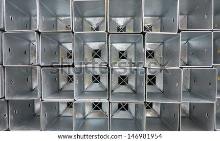 galvanized weft sleeves for fixing in the ground for garden - stock photo