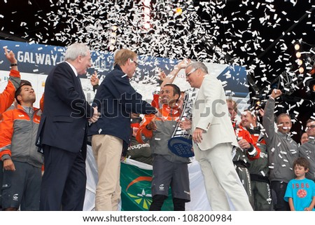 GALWAY, IRELAND - JULY 7: O. Persson,Volvo Group and S. Jacoby, present a trophy to Franck Cammas, Groupama, for first place overall in the Volvo Ocean Race 2011-12, on July 7,2012 in Galway, Ireland.