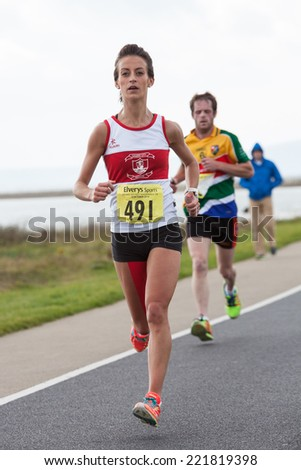 GALWAY, IRELAND - OCTOBER 4: Barbara Dunne compete during annual Galway Bay Half Marathon and 10K, on October 4, 2014 in Galway, Ireland. - stock photo