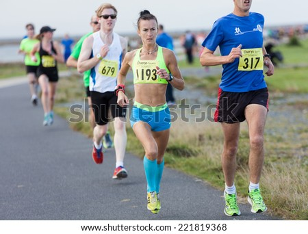 GALWAY, IRELAND - OCTOBER 4: Pauline Curley (1193), 2nd place, compete during annual Galway Bay Half Marathon and 10K, on October 4, 2014 in Galway, Ireland. - stock photo