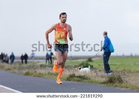 GALWAY, IRELAND - OCTOBER 4: Sergiu Ciobanu, winner, compete during annual Galway Bay Half Marathon and 10K, on October 4, 2014 in Galway, Ireland. - stock photo