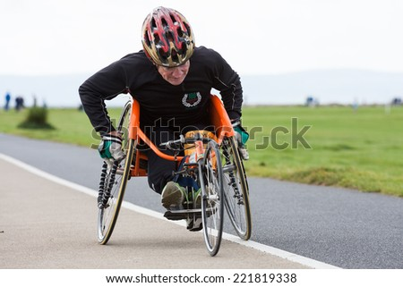 GALWAY, IRELAND - OCTOBER 4: Unidentified athlete athletes with disabilities compete during annual Galway Bay Half Marathon and 10K, on October 4, 2014 in Galway, Ireland. - stock photo