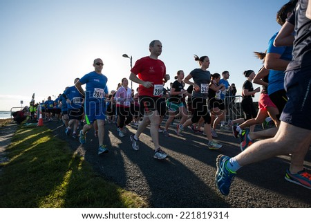 GALWAY, IRELAND - OCTOBER 4: Unidentified athletes compete during annual Galway Bay Half Marathon and 10K, on October 4, 2014 in Galway, Ireland. - stock photo