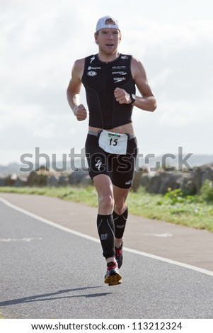 GALWAY, IRELAND - SEPTEMBER 2: Pro athlete Kirill Kotsegarov (15) competing at the Course Run, during 2nd Edition of the Ironman 70.3 Galway 2012 Triathlon, on September 2, 2012 in Galway, Ireland. - stock photo