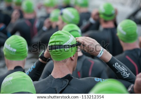 GALWAY, IRELAND - SEPTEMBER 2: Unidentified athletes  prepare to start  at Course Swim during 2nd Edition of the annual Ironman 70.3 Galway 2012 Triathlon,on September 2, 2012 in Galway, Ireland. - stock photo
