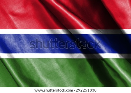 Gambia flag on soft and smooth silk texture - stock photo