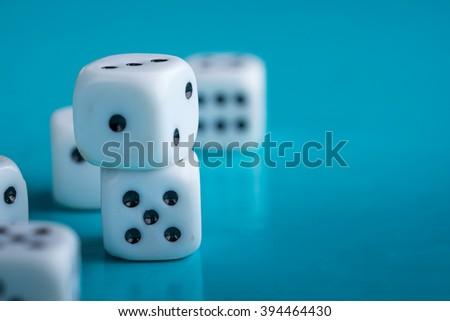 Gamble and taking risk concept - White dices against a blue background - Gambling - stock photo