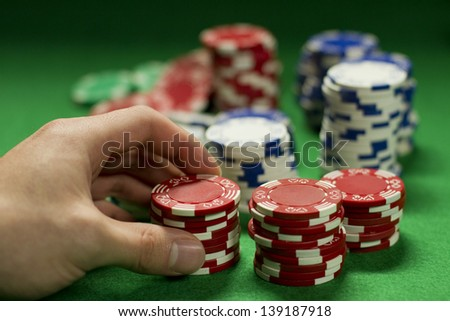 Gambler raises bet - stock photo