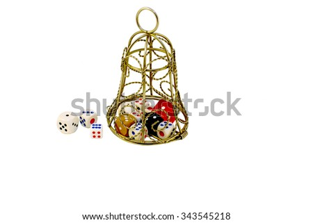gambling addiction. dice inside a metal bell. the concept of rehabilitation gamers in the church, Isolated on white background - stock photo