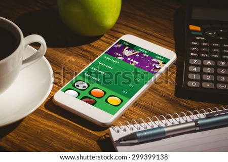 Gambling app screen against smartphone on table - stock photo