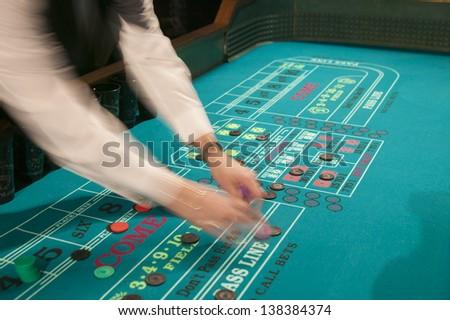 Gambling at a craps table. - stock photo