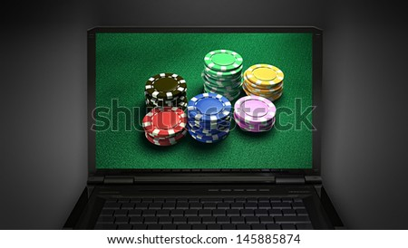 gambling chip is display on laptop screen - stock photo