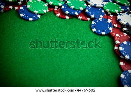 Gambling chips - bevel view with vignette - stock photo
