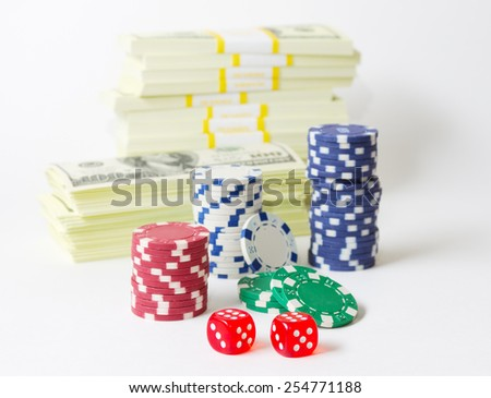 Gambling chips dices and heap of dollars isolated - stock photo