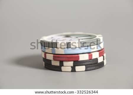 gambling chips on gray background - stock photo