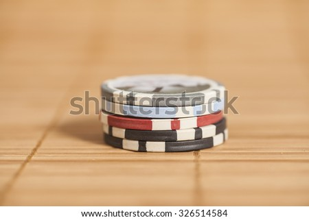 gambling chips on wooden background - stock photo