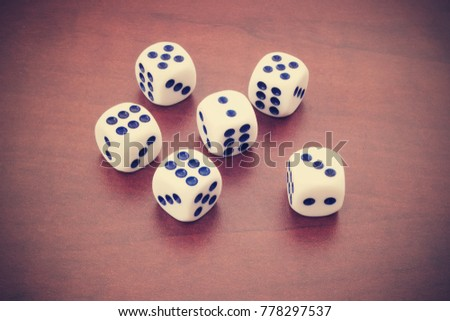 Gambling concept, dices on wooden table