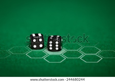 gambling, fortune, game, technology and entertainment concept - close up of black dice on green casino table and virtual projection - stock photo