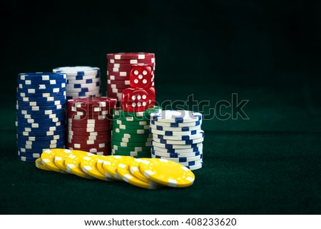Gambling Red Dice and Casino Money Chips - stock photo